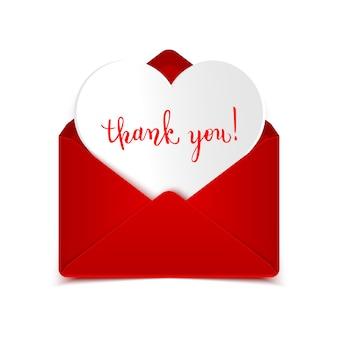 Dziękuję ręcznie pisany kaligraficzny sms w otwartej czerwonej kopercie z papierowym sercem na bielu