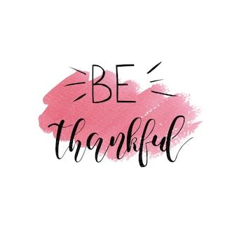 Dzień dziękczynienia napis bądź wdzięczny odręcznie napisana fraza na sezonowe jesienne wakacje na białym tle
