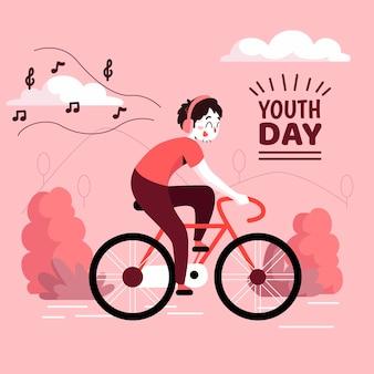Dzień młodzieży z rowerzystą słuchania muzyki na słuchawkach