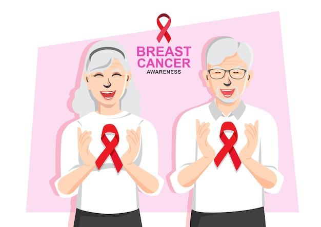 Dzień raka piersi para starszych wspieranie świadomości raka piersi razem, trzymając się za ręce czerwoną wstążką