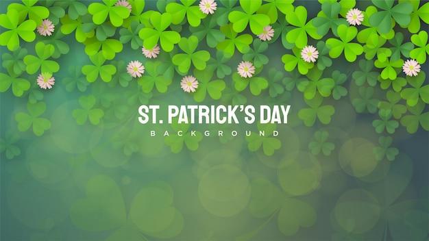 Dzień świętego patryka z zielonymi liśćmi posypanymi od góry do dołu.