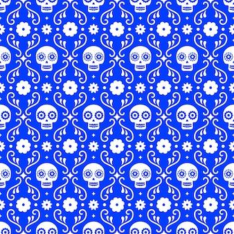 Dzień zmarłych szwu z czaszkami i kwiatami na niebieskim tle. tradycyjny meksykański projekt halloween na przyjęcie świąteczne dia de los muertos. ornament z meksyku.