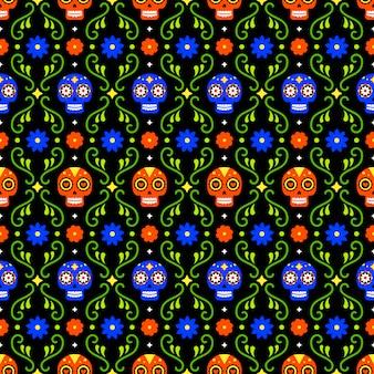 Dzień zmarłych wzór z kolorowe czaszki i kwiaty na ciemnym tle. tradycyjny meksykański projekt halloween na przyjęcie świąteczne dia de los muertos. ornament z meksyku.