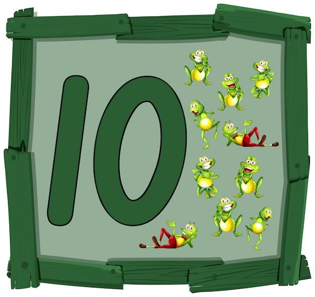 Dziesięć żab na drewnianym sztandarem