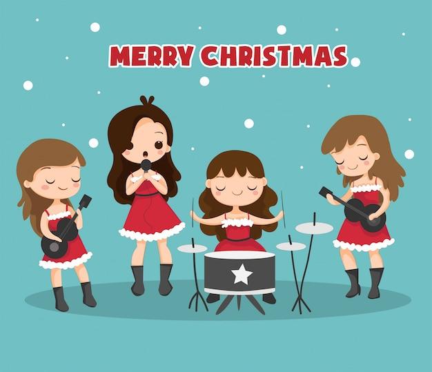 Dziewczęcy zespół muzyczny ubrany w strój świętego mikołaja na świąteczny festiwal