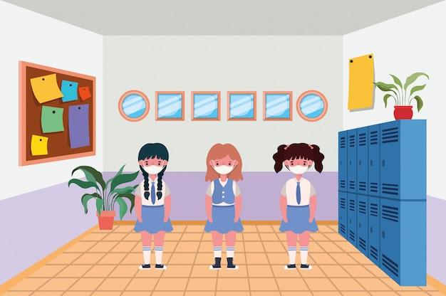 Dziewczęta dzieci z maskami w klasie