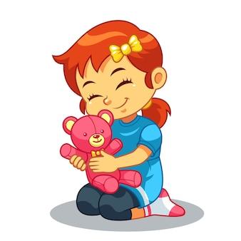 Dziewczyna bawi się jej lalka niedźwiedzia