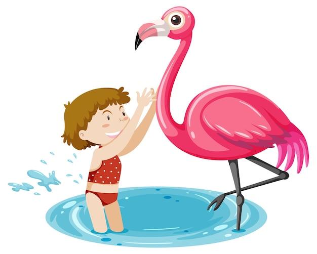 Dziewczyna bawi się z flamingiem na białym tle