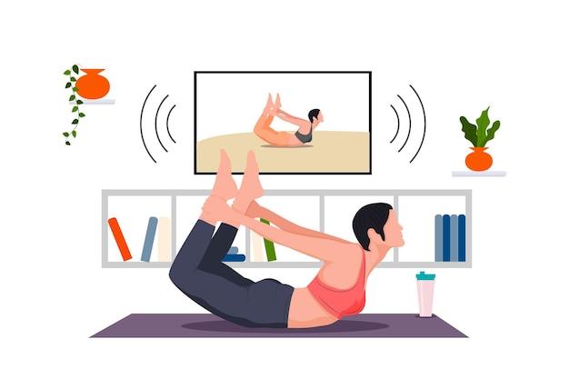 Dziewczyna ćwiczy jogę online w domu w telewizji pozuje do jogi, aby wzmocnić ulubione hobby ciała i ducha