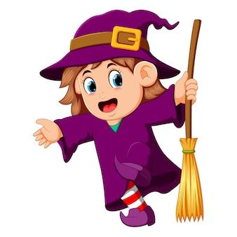 Dziewczyna czarownica z miotłą