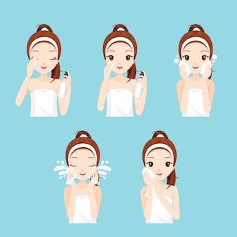 Dziewczyna czyszczenia i pielęgnacji twarzy z zestawem różnych działań