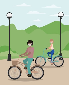 Dziewczyna i chłopiec z medyczną maską na cyklu przy parkiem