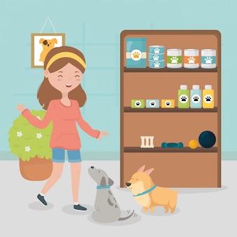 Dziewczyna i psy w weterynarzu z półką medycyny żywności opieki nad zwierzętami