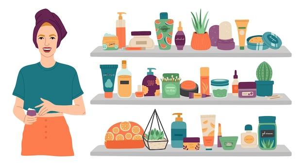 Dziewczyna i zestaw do makijażu, kobieta z ręcznikiem na głowie stoi przy półkach z kosmetykami do pielęgnacji twarzy.