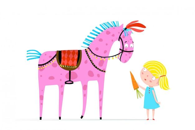 Dziewczyna karmi cyrkowego konia marchewką