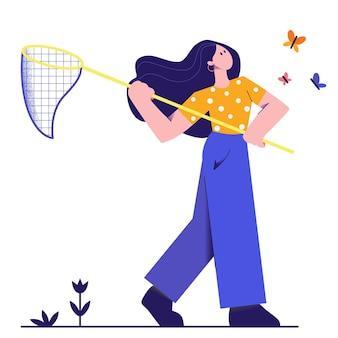 Dziewczyna łapie motyle z siatką.