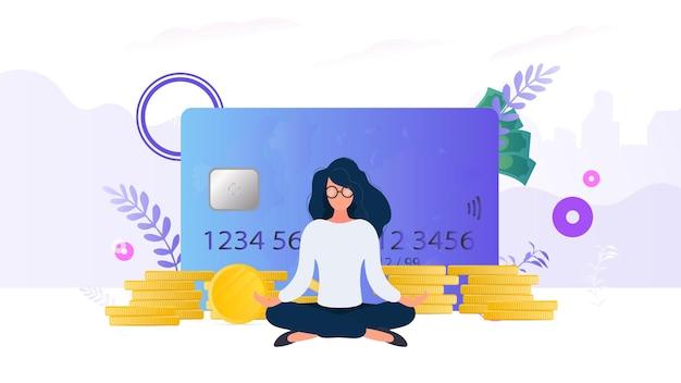 Dziewczyna medytuje na tle karty kredytowej z monetami i skarbonką. pojęcie oszczędności i akumulacji pieniędzy. dobry do prezentacji i artykułów związanych z biznesem.
