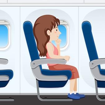 Dziewczyna na fotelu samolotu