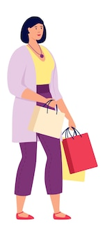 Dziewczyna na zakupy z torbami na prezenty na białym tle