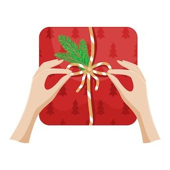 Dziewczyna pakuje prezent na boże narodzenie i zawiązuje kokardę. płaskie boże narodzenie ilustracja.