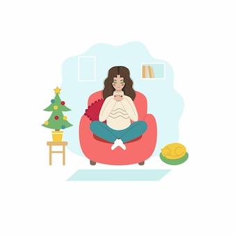 Dziewczyna pije kawę siedząc na kanapie. młoda kobieta poznaje nowy rok w domu. koncepcja obchodów nowego roku i bożego narodzenia. wektor znaków w stylu płaski.