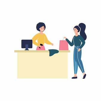 Dziewczyna płaci za zakup przy kasie. kobieta kupuje ubrania w sklepie. płaski charakter wektor. zakupy online przez internet.