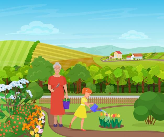 Dziewczyna podlewania kwiatów z babcią w wiosce
