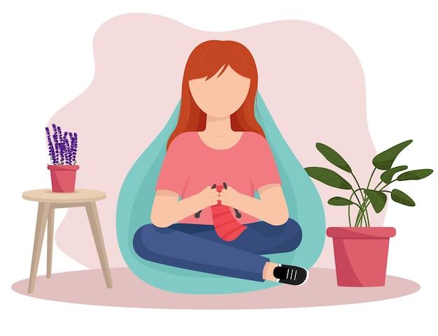 Dziewczyna robi na drutach. igły dziewiarskie. ilustracja wektorowa płaski.