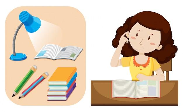 Dziewczyna robi pracie domowej na stole