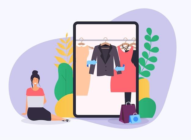 Dziewczyna robi zakupy online z laptopa