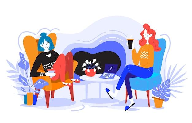 Dziewczyna siedzi na sofie, pracuje, rozmawia i pije kawę. ciepła i przytulna atmosfera.