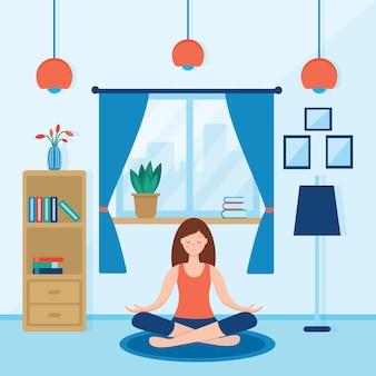 Dziewczyna siedzi ze skrzyżowanymi nogami w swoim pokoju lub mieszkaniu, ćwicząc jogę i ciesząc się medytacją