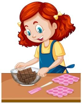 Dziewczyna szefa kuchni ze sprzętem do pieczenia na stole