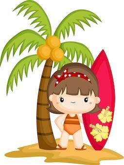 Dziewczyna trzyma deskę surfingową stojąc pod kokosowym drzewem