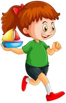 Dziewczyna trzyma postać z kreskówki zabawki statku na białym tle