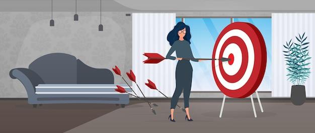 Dziewczyna trzyma strzałę. strzała trafia w cel. pojęcie udanego biznesu, pracy zespołowej i osiągania celów. wektor.