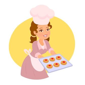 Dziewczyna trzyma tacę z ciasteczkami