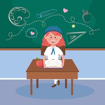Dziewczyna uczeń w biurku z książkową i jabłczaną owoc