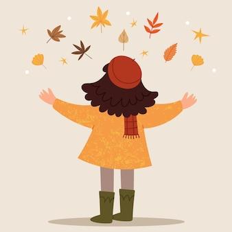 Dziewczyna w czerwonym berecie rzuca jesienne liście jesienny nastrój dzieciństwo szczęśliwa dziewczyna