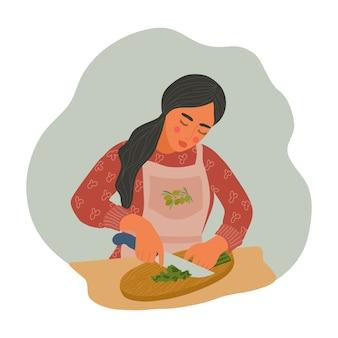 Dziewczyna w fartuchu kroi warzywa