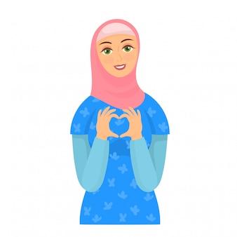 Dziewczyna w hidżab pokazano symbol serca palcami