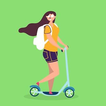 Dziewczyna w okularach przeciwsłonecznych jeździ skuterem ekologiczny transport
