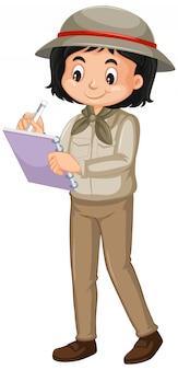 Dziewczyna w safari kostiumowym writing odizolowywającym