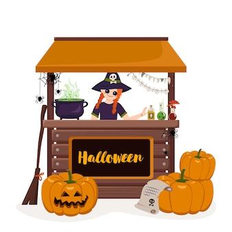Dziewczyna w spiczastym kapeluszu wiedźmy przy ladzie halloweenowej straganu z miksturą z kociołka dyni i pająkami jo...