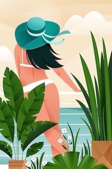 Dziewczyna w stroju kąpielowym i niebieskim kapeluszu patrzy na morze. letni plakat. tropikalny raj.