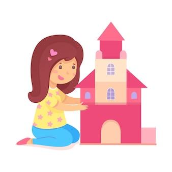 Dziewczyna w wieku przedszkolnym budowanie domu na piętrze