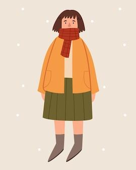 Dziewczyna z krótkimi włosami w jesiennych ubraniach w stylu skandynawskim