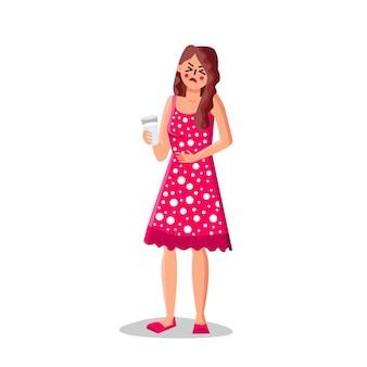 Dziewczyna z nietolerancją laktozy trzymać szklankę mleka