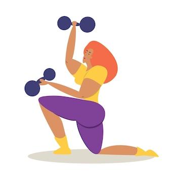 Dziewczyna zajmuje się sportem, trenerka sportowa z hantlami w dłoniach potrząsa mięśniami v...