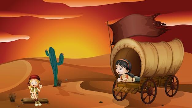 Dziewczynka leży wewnątrz wagonu i dziewczyna siedzi na drewno